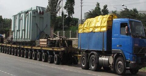 truck loaded with heavy machine